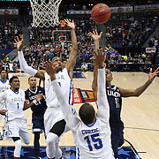 Ryan Boatright, UConn, shoots while defended by James Woodard and Marquel Curtis, Tulsa, during the UConn Huskies Vs Tulsa Semi Final game at the American Athletic Conference Men's College Basketball Championships 2015 at the XL Center, Hartford, Connecticut, USA. 14th March 2015. Photo Tim Clayton