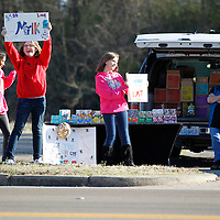 Thomas Wells | BUY at PHOTOS.DJOURNAL.COM<br /> Girl Scouts Cheyenne Guidry, 12, from left, Laura Layton, 12, and Sydney Ladd, 10, from troop 23818 spend Friday afternoon selling their Girl Scout cookies along West Main Street.