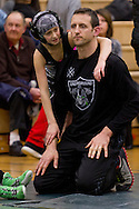 Slate Hill, New York - A wrestler talks to her coach (and father) during a youth wrestling tournament at Minisink Valley Middle School  on Feb. 21, 2014.