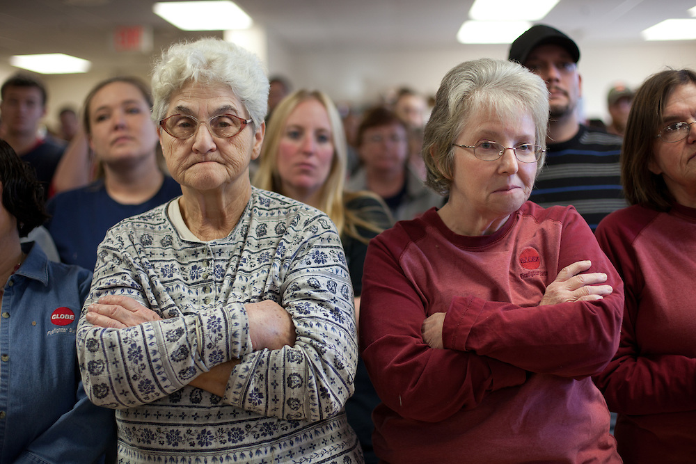PITTSFIELD, NH - JANUARY 04:  Globe Manufacturing Company employees Shirley Smith (L) and Pat Dexter listen as Republican presidential candidate, former Utah Governor Jon Huntsman Jr. speaks after touring their plant on January 04, 2012 in Pittsfield, New Hampshire. Huntsman continues to campaign hard in the nation's first primary state. Globe makes equipment for firefighters and other emergency workers. (Photo by Matthew Cavanaugh/Getty Images)..