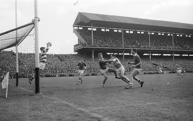 Cork goalie saves ball as players collide during the All Ireland Minor Gaelic Football final Cork V. Offaly in Croke Park on 27th September 1964.
