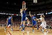 November 8, 2013: Sergej Vucetic (14) of the Nebraska Cornhuskers makes a jumper over Nate Hicks (1) of the Florida Gulf Coast Eagles in the second half at the Pinnacle Bank Areana, Lincoln, NE. Nebraska defeated Florida Gulf Coast 79 to 55.