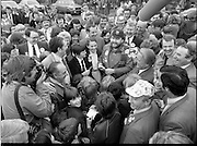 15/05/1982<br /> 05/15/1982<br /> 15 May 1982<br /> An Taoiseach, Mr Charles Haughey, canvasing with Fianna Fail bye-election candidate Eileen Lemass in Dublin West. Central group includes Brian Lenin Snr.; comedian Brendan Grace (Bottler) and An Taoiseach Charles Haughey.