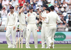 England's Chris Woakes (2nd left) celebrates taking the wicket of Pakistan's Asad Shafiq, during day one of the second Investec Test Match at Headingley Carnegie, Leeds.