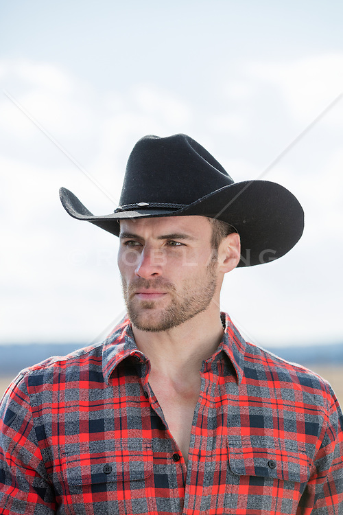 hot rugged cowboy outdoors on a ranch