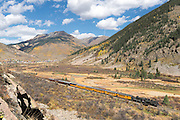 Durango & Silverton Narrow Gauge Railroad steam train along the Animas River in Southwest Colorado.