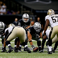 Aug 16, 2013; New Orleans, LA, USA; Oakland Raiders quarterback Matt Flynn (15) against the New Orleans Saints during the first quarter of a preseason game at the Mercedes-Benz Superdome. Mandatory Credit: Derick E. Hingle-USA TODAY Sports