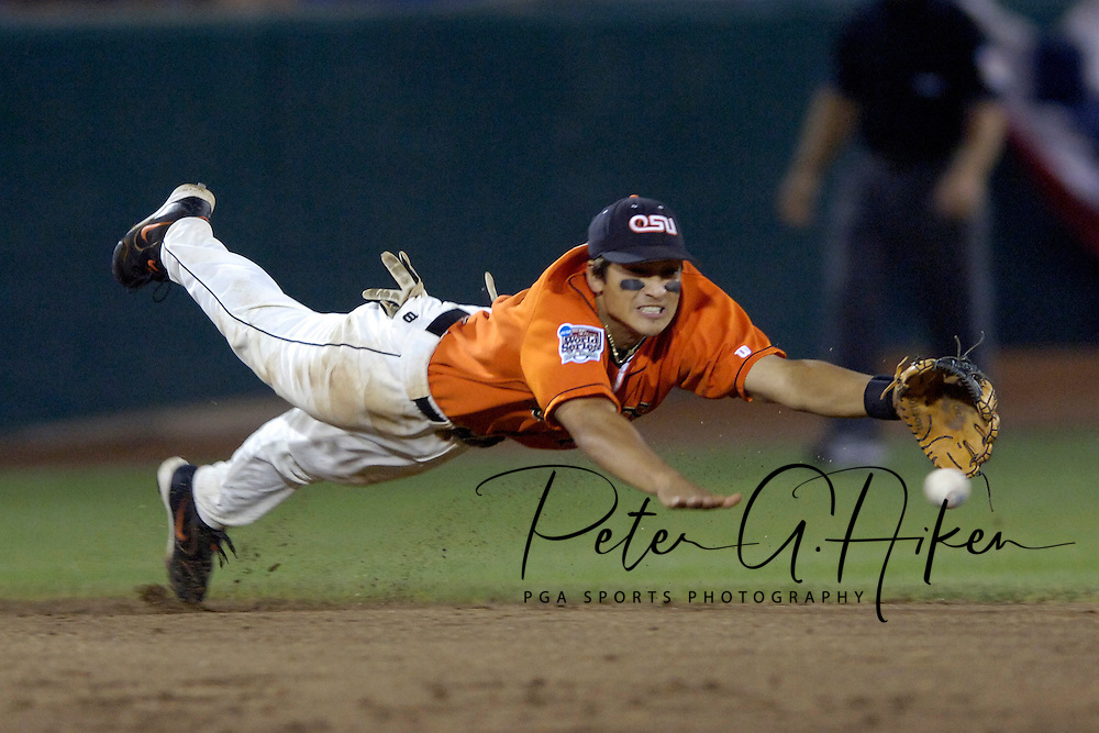 Oregon State shortstop Darwin Barney dives for a ground ball, off the bat of North Carolina's Seth Williams.  The ball got through, allowing the Tar Heels to score the tying run in the seventh inning.  North Carolina defeated Oregon State 4-3 in the first game of the Championship Series at the College World Series at Rosenblatt Stadium in Omaha, Nebraska, June 24, 2006.