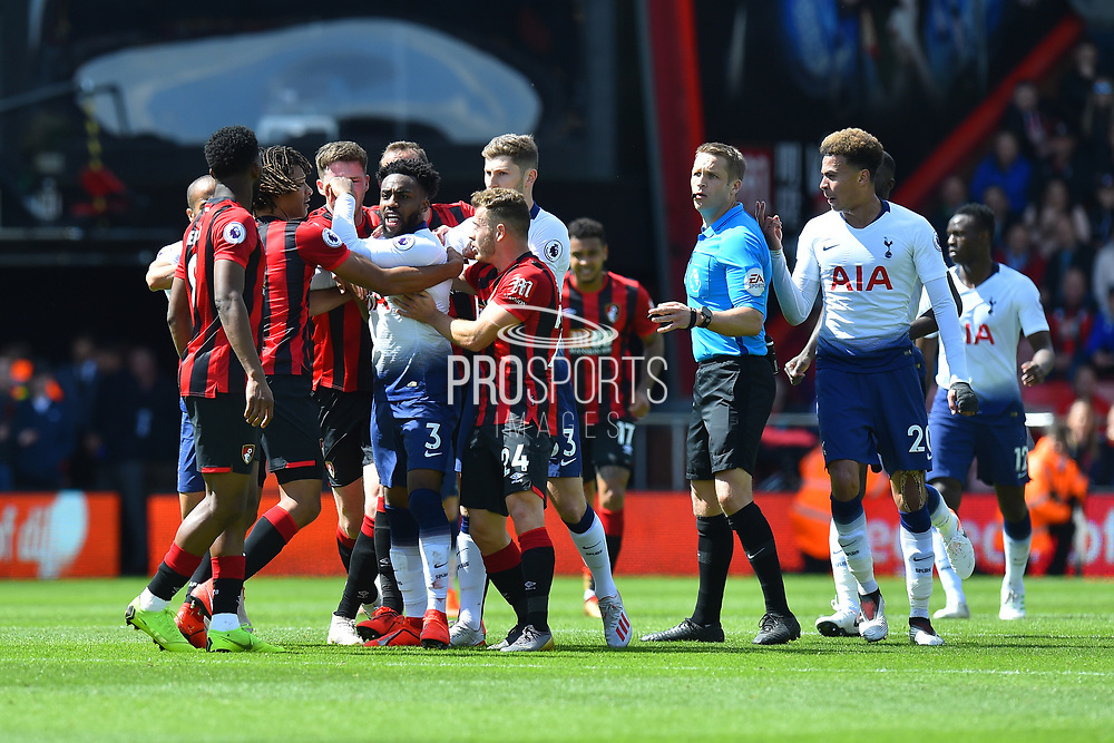 Danny Rose (3) of Tottenham Hotspur is held back as he tries to confront Jefferson Lerma (8) of AFC Bournemouth during the Premier League match between Bournemouth and Tottenham Hotspur at the Vitality Stadium, Bournemouth, England on 4 May 2019.