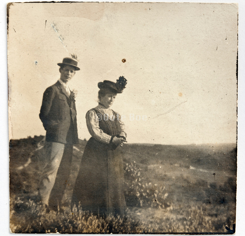 vintage portrait of mother with son posing outside in nature setting