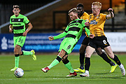 Forest Green Rovers Dayle Grubb(8) passes the ball forward under pressure from Cambridge United's Liam O'Neil(8) during the EFL Sky Bet League 2 match between Cambridge United and Forest Green Rovers at the Cambs Glass Stadium, Cambridge, England on 2 October 2018.