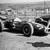#5 Alfa Special driven by Peter de Klerk; #18 Lotus 20 of Neville Lederle; #1 (far back) Cooper 53 of Trevor Blokdyk; #15 (behind the guy polishing) is the LDS Alfa of Sam Tingle at the 1962 Rand Autumn Trophy