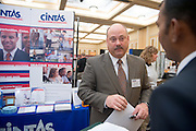 19082Fall Career Fair in Baker Center 10/08/08..Joe Bell, CINTAS talks to Santosh Vijapur