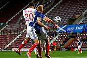 Dominic Solanke England U21s (Liverpool) & Ross McCrorie Scotland U21s (Rangers FC) challenge for the ball during the U21 UEFA EUROPEAN CHAMPIONSHIPS match Scotland vs England at Tynecastle Stadium, Edinburgh, Scotland, Tuesday 16 October 2018.