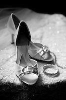 wedding shoes with dress and accessories shot in classic black and white