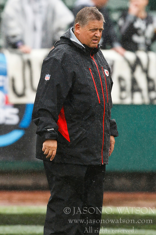 November 7, 2010; Oakland, CA, USA;  Kansas City Chiefs offensive coordinator Charlie Weis watches his team warm up before the game against the Oakland Raiders at Oakland-Alameda County Coliseum. Oakland defeated Kansas City 23-20 in overtime.