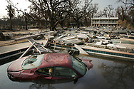Katrina storm aftermath : Coastal city of Biloxi in Mississippi was heavily damaged by the storm sea surge and high winds. A Jaguar car ends up in a swimming pool. 04 September 2005.