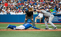 Aug 31, 2014; Toronto, Ontario, CAN; Toronto Blue Jays pinch runner Kevin Pillar (11) dives back to first base as New York Yankees first baseman Mark Teixeira (25) catches in the seventh inning against New York Yankees at Rogers Centre. Blue Jays won 4-3. Mandatory Credit: Peter Llewellyn-USA TODAY Sports