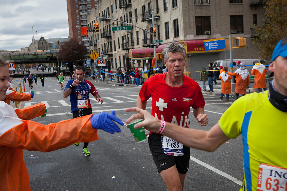 Participants pass a Gatorade stop as they run along 4th Ave in the New York City Marathon in Brooklyn, NY on Sunday, Nov. 3, 2013.<br /> <br /> CREDIT: Andrew Hinderaker for The Wall Street Journal<br /> SLUG: NYSTANDALONE