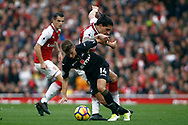 Tom Carroll of Swansea City (R) turns away from Hector Beller&iacute;n of Arsenal (L). Premier league match, Arsenal v Swansea city at the Emirates Stadium in London on Saturday 28th October 2017.<br /> pic by Steffan Bowen, Andrew Orchard sports photography.