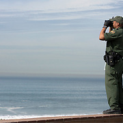 U.S. Border Patrol agents scan for undocumented migrants and smugglers along the Imperial Beach section of San Diego, California across from Tijuana, Mexico. Please contact Todd Bigelow directly with your licensing requests.