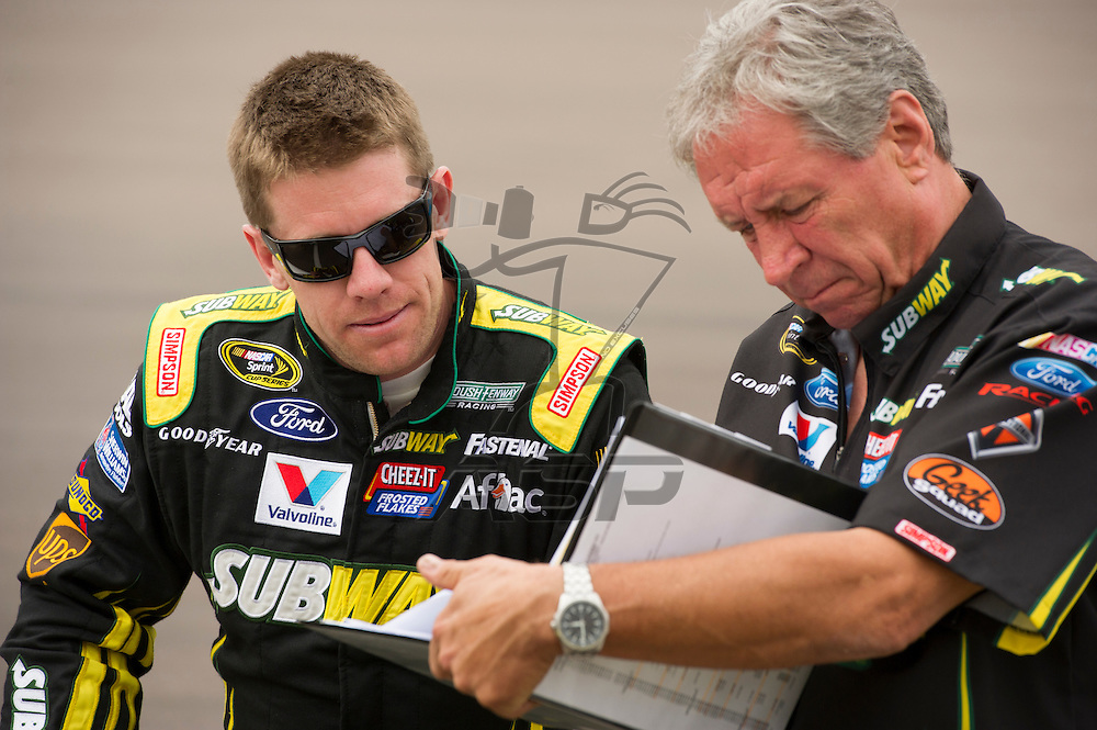 AVONDALE, AZ - Mar 03, 2013: Carl Edwards (99) talks with his crew chief Jimmy Fenning before the Subway Fresh Fit 500 at the Phoenix International Raceway in AVONDALE, AZ.
