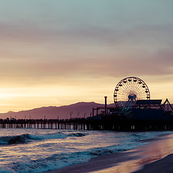 Santa Monica Pier sunset retro panoramic photo. Santa Monica is a coastal beach city along the Pacific Ocean in Southern California in the United States. Panorama photo ratio is 1:3. Copyright ⓒ 2017 Paul Velgos with All Rights Reserved.