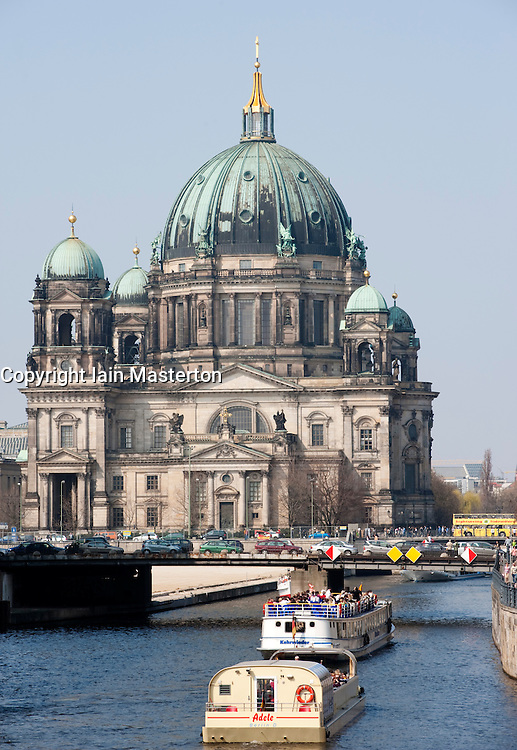 Berlin Cathedral with tour boats on Spree River in central Berlin 2009