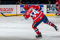 KELOWNA, CANADA - MARCH 5: Adam Helewka #14 of the Spokane Chiefs takes a shot during warm up against the Kelowna Rockets on March 5, 2014 at Prospera Place in Kelowna, British Columbia, Canada.   (Photo by Marissa Baecker/Getty Images)  *** Local Caption *** Adam Helewka;
