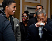 Ohio University President Roderick J. McDavis, right, shares a laugh with students at the All Black Affair at Baker University Center Ballroom at Ohio University on Friday, January 29, 2016. © Ohio University / Photo by Sonja Y. Foster