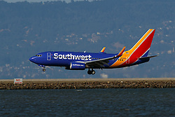 Boeing 737-7H4 (N919WN) operated by Southwest Airlines landing at San Francisco International Airport (KSFO), San Francisco, California, United States of America