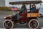 A Cadillac Going over Westminster Bridge - Bonhams London to Brighton Veteran Car Run celebrates the 122nd anniversary of the original Emancipation Run of 1896 which celebrated the passing into law the Locomotives on the Highway Act so raising the speed limit for 'light automobiles' from 4mph to 14mph and abolishing the need for a man to walk in front of all vehicles waving a red flag. The Movember Foundation as our Official Charity Partner.