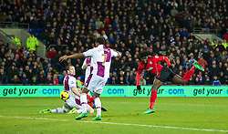 CARDIFF, WALES - Tuesday, February 11, 2014: Cardiff City's Kenwyne Jones sees his header saved against Aston Villa during the Premiership match at the Cardiff City Stadium. (Pic by David Rawcliffe/Propaganda)