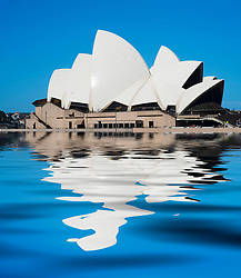View of Sydney Opera House reflected in harbour  in Sydney Australia