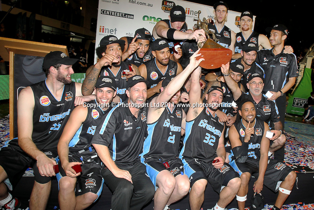 Breakers' Paul Henare lifts the Dr. John Raschke Trophy with the team. iinet ANBL, Grand Final Game 3, New Zealand Breakers vs Cairns Taipans, North Shore Events Centre, Auckland, New Zealand. Friday 29th April 2011. Photo: Anthony Au-Yeung / photosport.co.nz