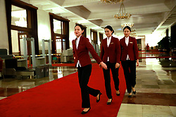 epa06270824 Chinese hostesses walk inside the Great Hall of the People (GHOP) where the 19th National Congress of the Communist Party of China (CPC) will be held in Beijing, China, 17 October 2017. The five-yearly 19th National Congress of the Communist Party of China (CPC) will begin on 18 October.  EPA-EFE/HOW HWEE YOUNG