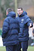 James Marrs discuss his option with Daniel Wright during the Women's FA Cup match between Watford Ladies FC and Brighton Ladies at the Broadwater Stadium, Berkhampstead, United Kingdom on 1 February 2015. Photo by Stuart Butcher.
