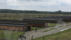Barracks at the Auschwitz-Birkenau Nazi concentration camps in Auschwitz, Poland on September 3, 2017. Auschwitz concentration camp was a network of German Nazi concentration camps and extermination camps built and operated by the Third Reich in Polish areas annexed by Nazi Germany during WWII. It consisted of Auschwitz I (the original camp), Auschwitz II–Birkenau (a combination concentration/extermination camp), Auschwitz II–Monowitz (a labor camp to staff an IG Farben factory), and 45 satellite camps. In September 1941, Auschwitz II–Birkenau went on to become a major site of the Nazi Final Solution to the Jewish Question. From early 1942 until late 1944, transport trains delivered Jews to the camp's gas chambers from all over German-occupied Europe, where they were killed en masse with the pesticide Zyklon B. An estimated 1.3 million people were sent to the camp, of whom at least 1.1 million died. Around 90 percent of those killed were Jewish; approximately 1 in 6 Jews killed in the Holocaust died at the camp. Others deported to Auschwitz included 150,000 Poles, 23,000 Romani and Sinti, 15,000 Soviet prisoners of war, 400 Jehovah's Witnesses, and tens of thousands of others of diverse nationalities, including an unknown number of homosexuals. Many of those not killed in the gas chambers died of starvation, forced labor, infectious diseases, individual executions, and medical experiments. In 1947, Poland founded a museum on the site of Auschwitz I and II, and in 1979, it was named a UNESCO World Heritage Site. Photo by Somer/ABACAPRESS.COM