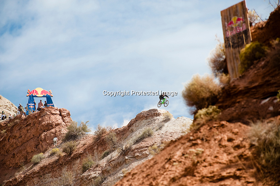 Alex Prochazka races down a ridge line at the 2010 Red Bull Rampage