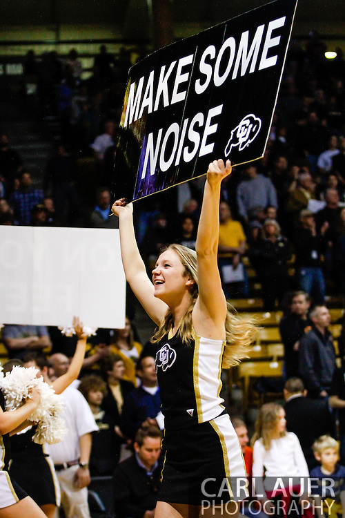 January 18th, 2014:  A Colorado cheerleader pumps up the crowd before the start of the NCAA Basketball game between the USC Trojans and the University of Colorado Buffaloes at the Coors Events Center in Boulder, Colorado