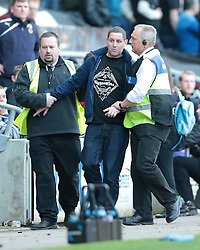 A Wolves fan gets ejected from the ground  - Photo mandatory by-line: Nigel Pitts-Drake/JMP - Tel: Mobile: 07966 386802 29/03/2014 - SPORT - FOOTBALL -  Stadium MK - Milton Keynes - Milton Keynes Dons v Wolverhampton Wanderers - Sky Bet League One