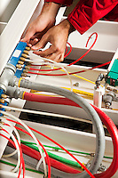 Technician fixing cabling and wiring circuit