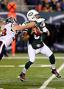 New York Jets quarterback Mark Sanchez (6) gets stripped of the ball on a hit by Houston Texans outside linebacker Brooks Reed (58) during the NFL week 5 football game against the Houston Texans on Monday, Oct. 8, 2012 in East Rutherford, N.J. The Texans won the game 23-17. ©Paul Anthony Spinelli
