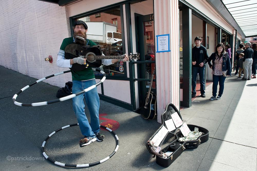 Hula-hoop guitarist. Seattle, Pike Market