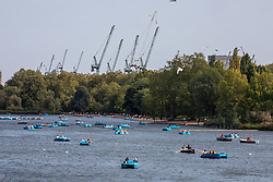 © Licensed to London News Pictures. 19/09/2020. London, UK. Members of the public enjoy the warm sunshine the Serpentine in Hyde Park on the first weekend of the Rule of Six. Gatherings of over six people have now been banned by the Government after a spike in coronavirus cases. Prime Minister Boris Johnson announced yesterday that the UK was heading for a second wave with the North East already under lockdown.  Photo credit: Alex Lentati/LNP