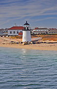 The Brant Point Lighthouse at the entrance to Nantucket Harbor. The 26 foot tall white wooden lighthouse, which welcomes visitors to Nantucket Harbour, is the lowest in New England.