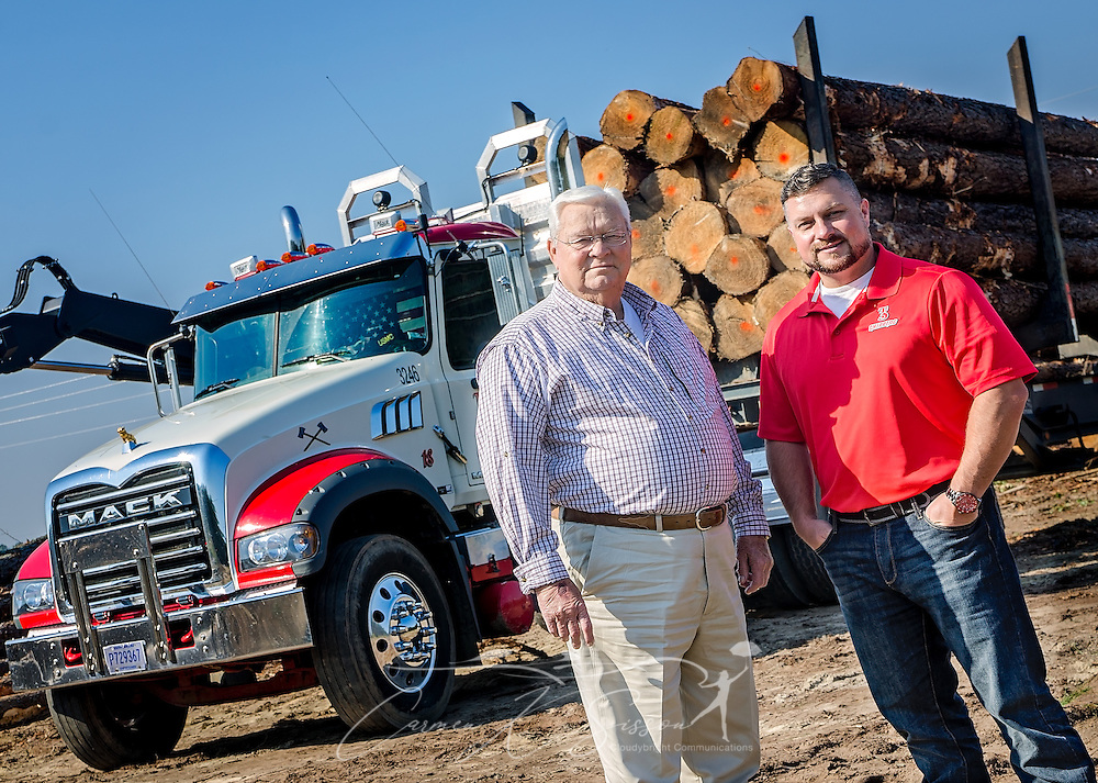 Tracy Gunter Jr. and his son, Tracy Gunter III, stand on a job site with one of the Mack Granites they use in their logging business, Nov. 16, 2016, in Steadham, S.C. The men own and operate Tracy's Logging and T3 Chipping, where they oversee four logging crews and two chpping crews, averaging 300 loads per week. (Photo by Carmen K. Sisson)