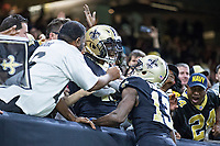 NEW ORLEANS, LA - NOVEMBER 19:  Alvin Kamara #41 of the New Orleans Saints celebrates with fans after scoring a touchdown during a game against the Washington Redskins at Mercedes-Benz Superdome on November 19, 2017 in New Orleans, Louisiana.  Saints defeated the Redskins 34-31.  (Photo by Wesley Hitt/Getty Images) *** Local Caption *** Alvin Kamara