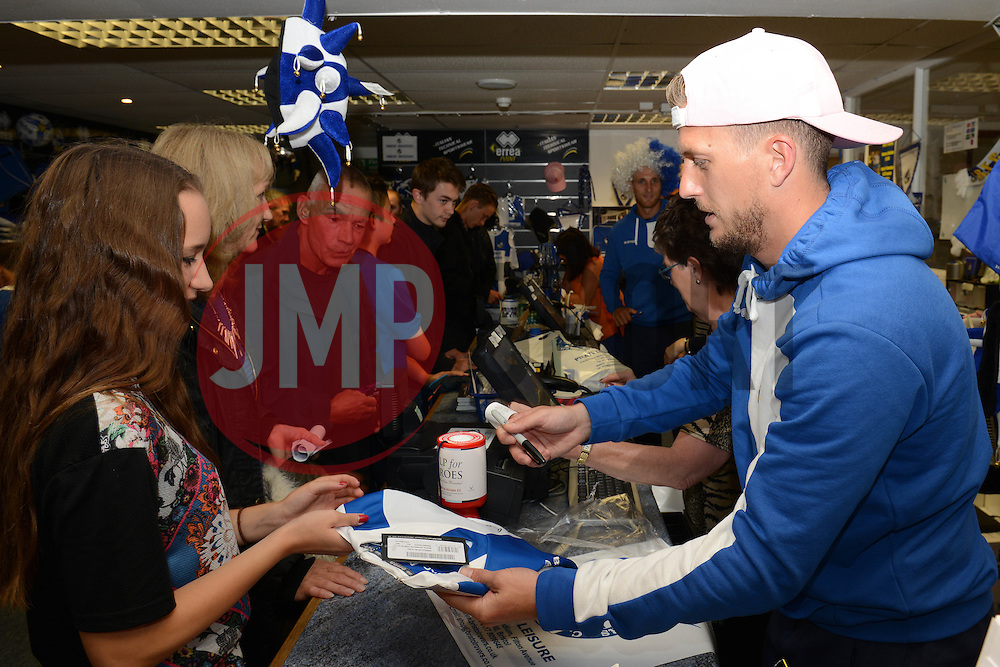 Lee Mansell helps out at the club shop during the open day at the memorial stadium  - Mandatory by-line: Dougie Allward/JMP - 07966386802 - 26/07/2015 - SPORT - FOOTBALL - Bristol,England - Memorial Stadium - Bristol Rovers Open Day - Bristol Rovers Open Day