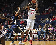 """Ole Miss' Reginald Buckner (23) is fouled by East Tennessee State's John Walton (21) at the C.M. """"Tad"""" Smith Coliseum in Oxford, Miss. on Saturday, December 14, 2012. Mississippi won 77-55 to improve to 7-1. (AP Photo/Oxford Eagle, Bruce Newman).."""